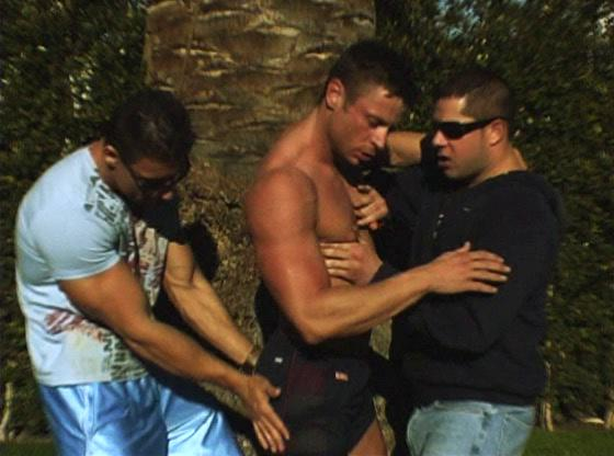 Muscled gay stud gets over-decorated in gay threesome action