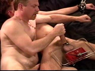 Dude adjacent to leg added to feet restraints gets his cock added to balls smashed wits his master