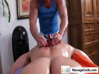 Studly masseuse gives gay boy Dylan a deep rub-down with toys