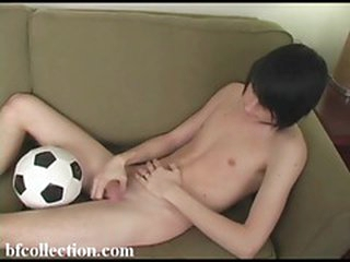 Cute twink plays with a big dick primarily the couch