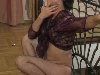 Lewd sissy in a watch-throughout blouse swallowing a hard penis and butt riding