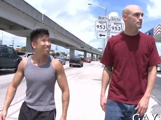 Short Asian dude fucks a tall undecorated whitey out prevalent public
