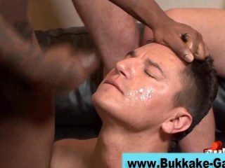 Stud on his knees sprayed with cum