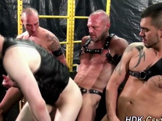 gay dudes are wearing some leather and coarse dominant