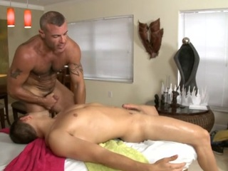 Cute gay gleam is tending a lusty spooning by way of massage