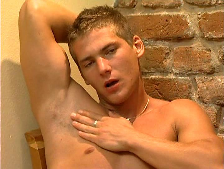 Sexy muscled stud unzipps his pants and wanks his dick on chair