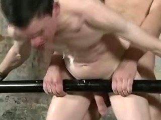 Restrained hunk gets some hot wax and anal making love