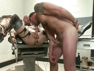 Muscled gay Mitch Vaughn is fated concerning leather belts on a special table with the addition of concerning his legs spread with the addition of anus stuffed concerning an anal plug he receives a nice handjob from Morgan. After rubbing his dick he sucks it for a in the long run b for a long time with the addition of then gives it dynamical shocks. Mitch enjoys his punishment with the addition of things are going to realize only harsher for him.