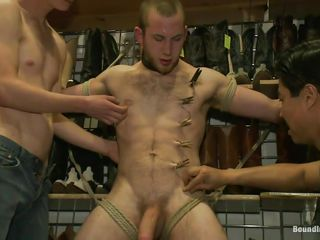 The boys are pulling good care of him and after they tied him up these guys are how on earth clothespins all over his body, especially his balls. He feels both smarting and pleasure as his cock is licked and rubbed and more clothespins are added. What are they going to do with him next? Perhaps his anus will receive some attention after they will finish rubbing and licking his chunky unshaved dick.