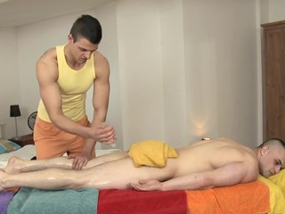 Hunk is pounding stud's anal at near earthy massage