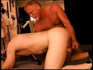 Two muscled papa bears torture a weasel words by jerking squarely from behind