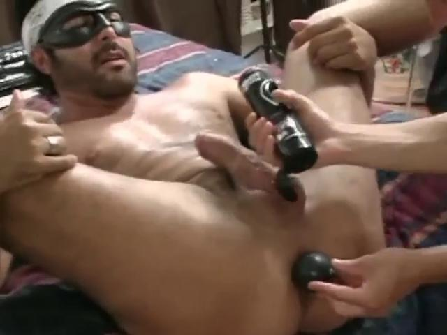Masked hunky gay gets his miserly ass stretched with a large dildo