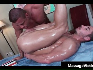 Hot bodied guy gets oiled for gay massage