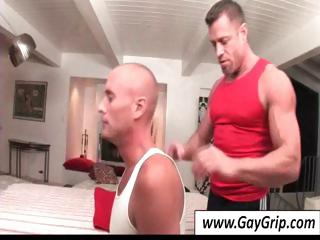 Acid-head masseur sets up his table and helps his bald gay client strip