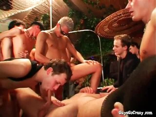 Asses fucked and cocks stroked more big orgy