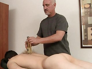 Skinny homosexual gets his hard cock oiled and massaged