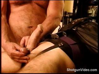 Slave gets some hideous torture from his master on his cock increased by balls