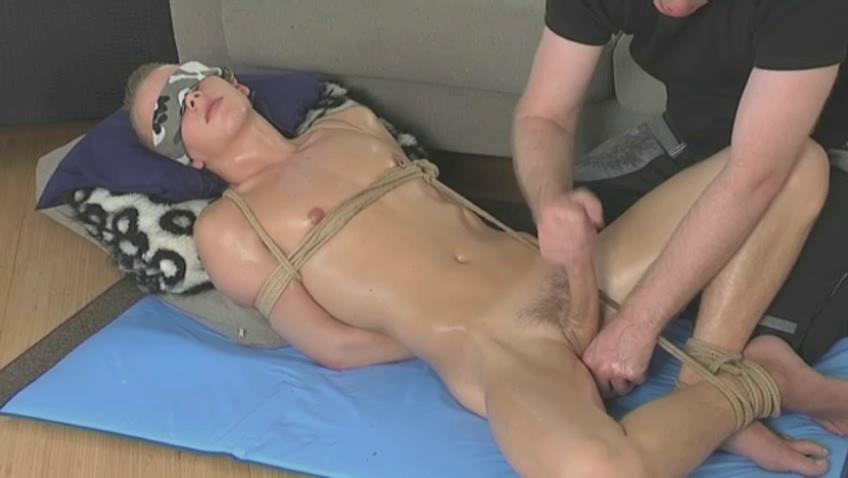 Tied up twink possessions his dick stroked