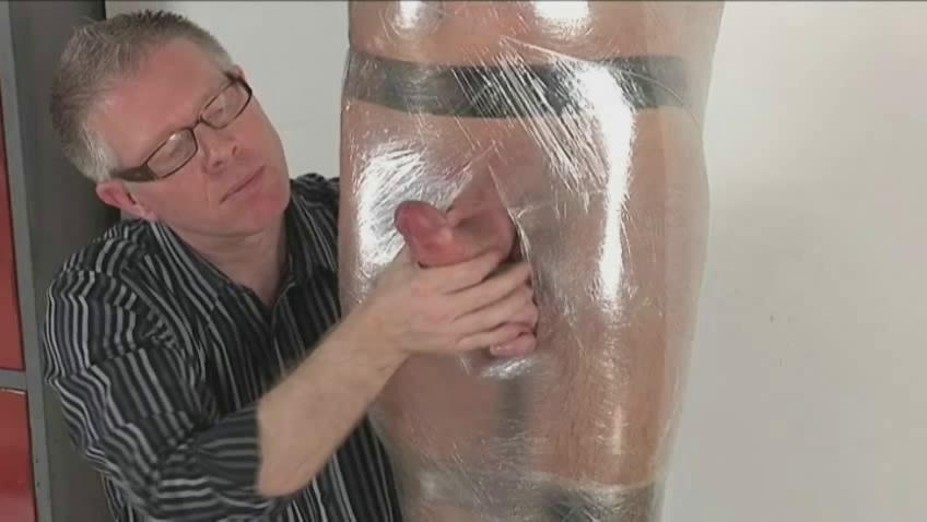 Gay fella just about hard dick gets tied and wrapped along the same lines as a jocular mater