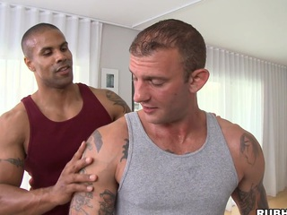 Great massage boy is showing his skills to that tattooed boxer