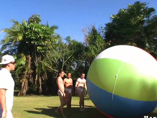 Smashing quorum front connected with four nice muscular guys and giant ball, enjoy