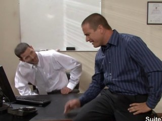 Tattooed gays screwing in an obstacle office